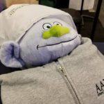 Stuffed troll in an AADOM hoodie