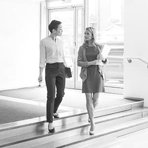 Two office managers walking down a hall