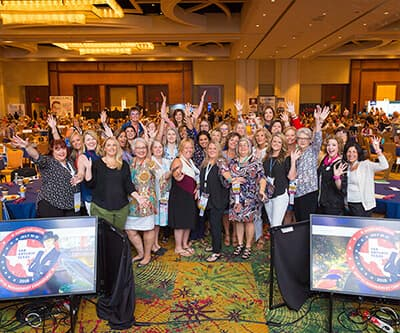 Woman celebrating and taking a photo together at the annual AADOM conference