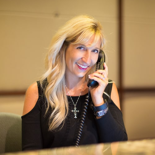 Blonde woman talking on the phone and smiling