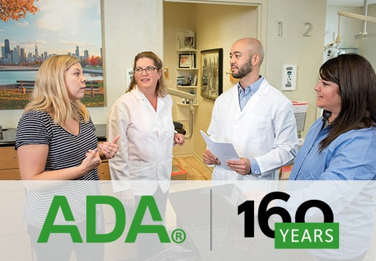The ADA Hall team working together with the ADA logo celebrating 160 years.