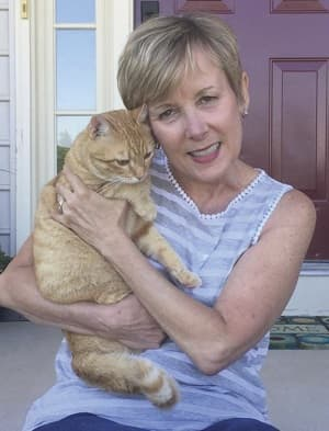 Profile photo of author Jane Walkley and her cat Charlie.