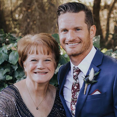 Portrait of Author, Lori Dobrik, and her son Bryan at his wedding.
