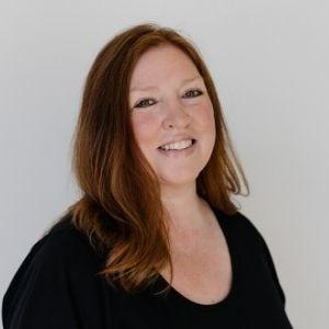 Pam Good Michelson, FAADOM wearing a black top smiliing