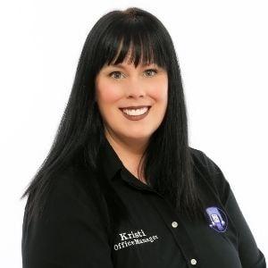 Kristi Abrahamsen wearing black scrubs
