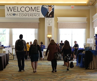 AADOM members filing in to AADOM Conference