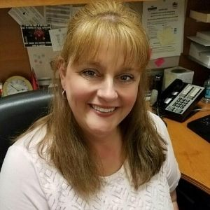 Sharon Garner in her office wearing a white top