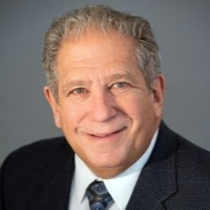 Dr. Steven Katz in a suit
