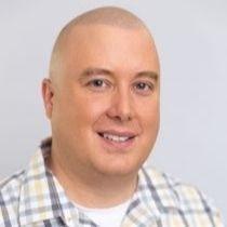Nathan Yoder in plaid shirt.